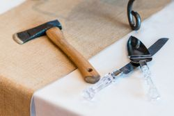 April_Matt_Park_City_Legacy_Lodge_Park_City_Utah_Wedding_Cake_Knife_Hatchet.jpg