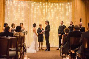 Julia_Mark_Silver_Lake_Lodge_Deer_Valley_Resort_Park_City_Utah_Ceremony_In_Front_Of_Shimmering_Backdrop.jpg