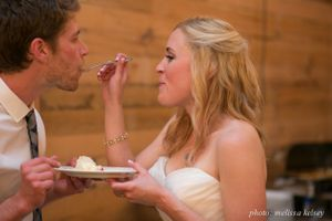 Lenora_John_Sundance_Resort_Sundance_Utah_Bride_Groom_Feeding_Groom_Wedding_Cake.jpg