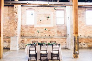 Modern_Industrial_Wedding_Shoot_The_Historic_Startup_Building_Provo_Utah_Old_Warehouse_Elegant_Table.jpg