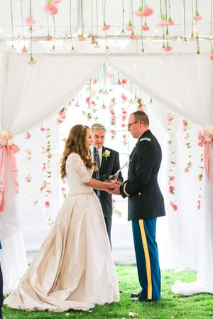 Katelyn_David_Park_City_Utah_Vows_Surrounded_By_Pink_Carnations.jpg