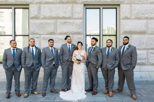 Tessa_Taani_Utah_State_Capitol_Salt_Lake_City_Utah_Bride_Posing_With_Groomsmen.jpg