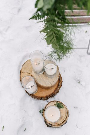 Rocky_Mountain_Bride_Winter_Elopement_Deer_Valley_Empire_Lodge_Deer_Valley_Resort_Park_City_Utah_Ceremony_Decor_Greenery_Lighted_Cylinder_Candles.jpg