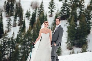 Ilana_Dave_Canyons_Resort_Park_City_Utah_Bride_Groom_Posing_on_Slopes_in_Dress_and_Suit.jpg