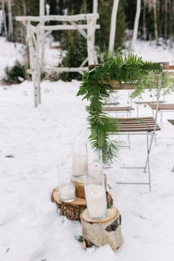 Rocky_Mountain_Bride_Winter_Elopement_Deer_Valley_Empire_Lodge_Deer_Valley_Resort_Park_City_Utah_Ceremony_Detail_Tree_Stumps_Cylinder_Vase_Candles.jpg